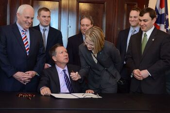Dr. Joan Papp at the signing of HB 170